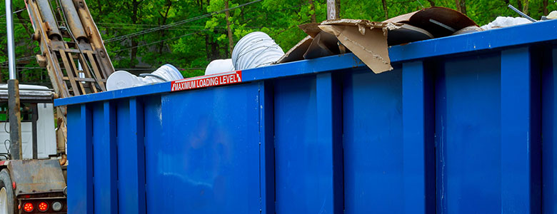 LJP dumpster getting picked up.